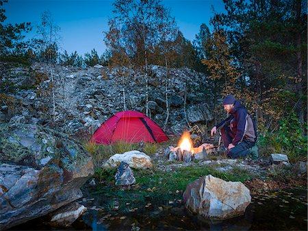 Man having campfire Stock Photo - Premium Royalty-Free, Code: 6102-08271129