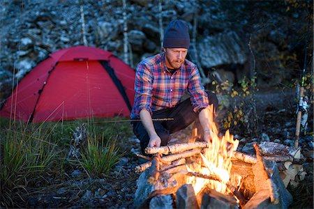Man having campfire Stock Photo - Premium Royalty-Free, Code: 6102-08271133