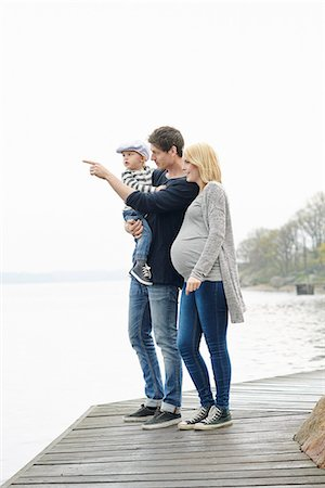 Family with son on jetty Stock Photo - Premium Royalty-Free, Code: 6102-08271310
