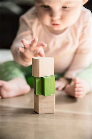 Wooden blocks, baby on background Stock Photo - Premium Royalty-Free, Code: 6102-08271789