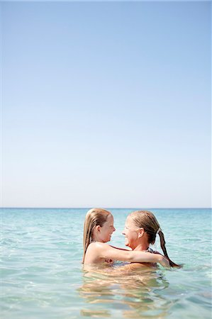 Mother and daughter in sea Stock Photo - Premium Royalty-Free, Code: 6102-08278797