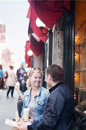 Couple with take away coffee Stock Photo - Premium Royalty-Free, Code: 6102-08278841