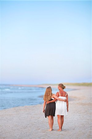 Mother with daughter walking on beach Stock Photo - Premium Royalty-Free, Code: 6102-08278878