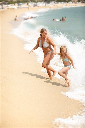 Mother with daughter on beach Stock Photo - Premium Royalty-Free, Code: 6102-08278929