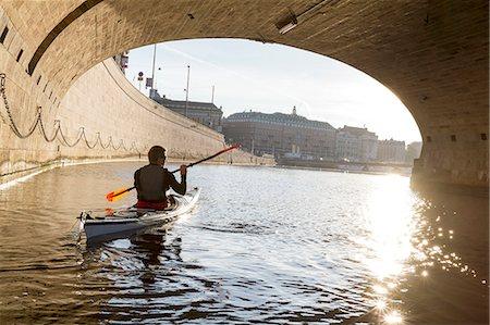 Man kayaking on sea Stock Photo - Premium Royalty-Free, Code: 6102-08384236