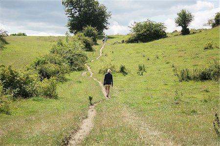 forward - People walking through meadow Stock Photo - Premium Royalty-Free, Code: 6102-08384345