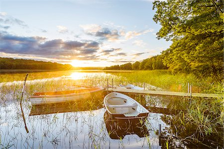 Rowboats at sunset Stock Photo - Premium Royalty-Free, Code: 6102-08388027