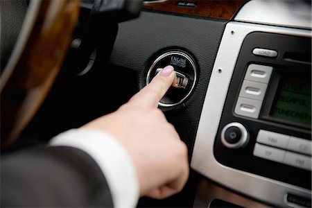 finger - Female car driver pushing button Stock Photo - Premium Royalty-Free, Code: 6102-08388255