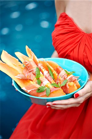 Woman holding food in bowl Stock Photo - Premium Royalty-Free, Code: 6102-08480803