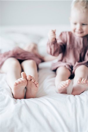 female feet close up - Brother and sister on bed Stock Photo - Premium Royalty-Free, Code: 6102-08542147