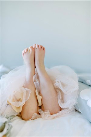 Girl lying on bed Stock Photo - Premium Royalty-Free, Code: 6102-08542110