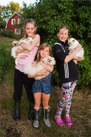 preteen girl pussy - Portrait of three girls holding pets Stock Photo - Premium Royalty-Free, Code: 6102-08558793