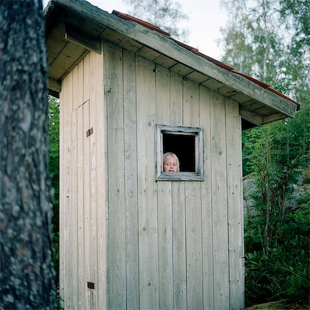 Girl in outhouse Stock Photo - Premium Royalty-Free, Code: 6102-08558889