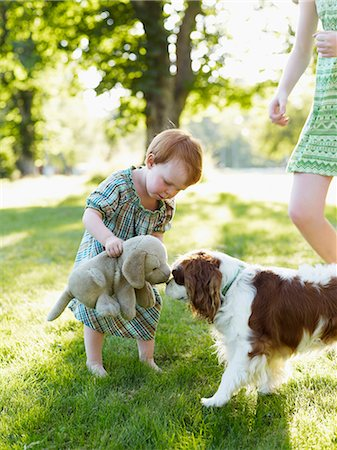 preteen kissing - Baby girl and older sister playing with dog in park Stock Photo - Premium Royalty-Free, Code: 6102-08559095