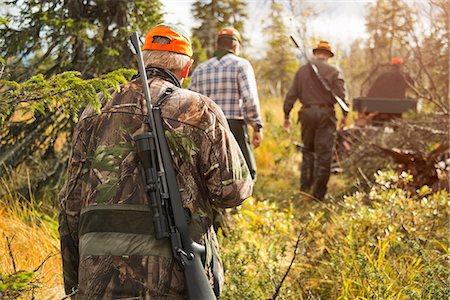 Men at hunting Stock Photo - Premium Royalty-Free, Code: 6102-08559218