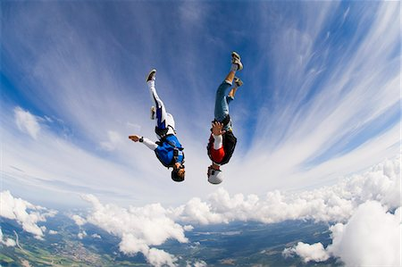 Young couple upside-down in air Stock Photo - Premium Royalty-Free, Code: 6102-08566127