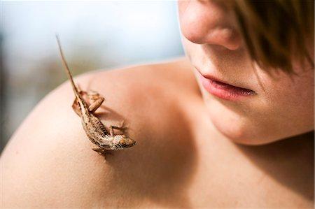preteen boy shirtless - Lizard on boys shoulder Stock Photo - Premium Royalty-Free, Code: 6102-08566336