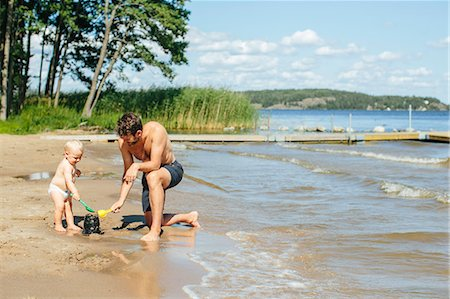 father son bath - Father playing on beach Stock Photo - Premium Royalty-Free, Code: 6102-08566515