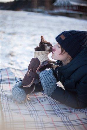 dog kissing girl - Girl with dog Stock Photo - Premium Royalty-Free, Code: 6102-08520950