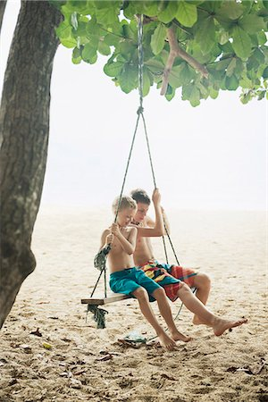 preteen boy shirtless - Boys on swing Stock Photo - Premium Royalty-Free, Code: 6102-08520971