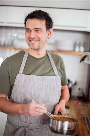 Man in kitchen Stock Photo - Premium Royalty-Free, Code: 6102-08521149
