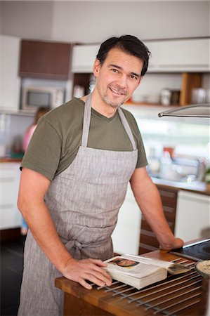 Man in kitchen Stock Photo - Premium Royalty-Free, Code: 6102-08521151