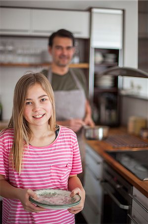 Daughter with father in kitchen Stock Photo - Premium Royalty-Free, Code: 6102-08521152