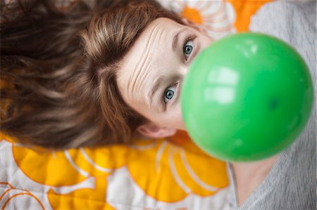 dece11 - Portrait of girl with green balloon Stock Photo - Premium Royalty-Free, Code: 6102-08521133