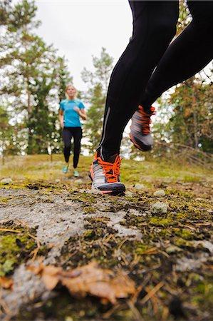 forward - Two women jogging through forest Stock Photo - Premium Royalty-Free, Code: 6102-08746109