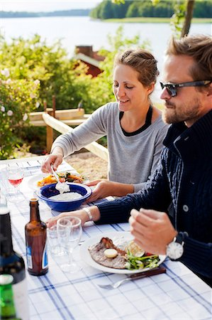 Couple having meal outdoors Stock Photo - Premium Royalty-Free, Code: 6102-08746435