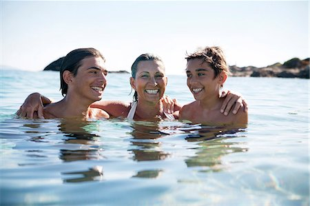 preteen boy shirtless - Mother with sons bathing in sea Stock Photo - Premium Royalty-Free, Code: 6102-08746527