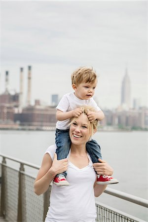 Mother with son on her shoulders Stock Photo - Premium Royalty-Free, Code: 6102-08746804