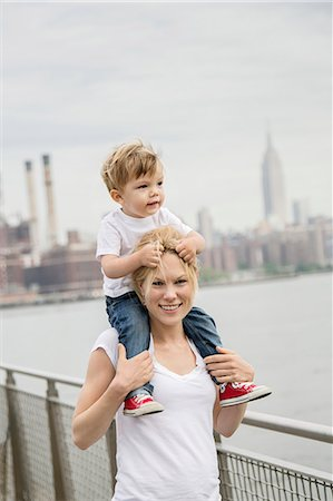 Mother with son on her shoulders Stock Photo - Premium Royalty-Free, Code: 6102-08746805