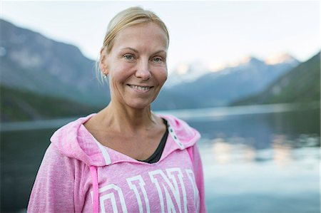 Portrait of smiling woman at lake Stock Photo - Premium Royalty-Free, Code: 6102-08747042