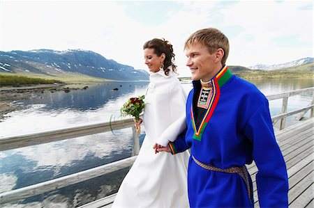 Newlywed couple on jetty Stock Photo - Premium Royalty-Free, Code: 6102-08760402