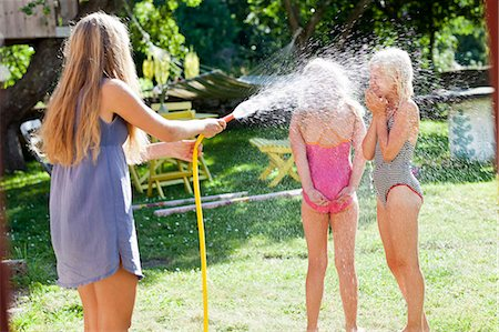preteen girls bath - Children playing in garden Stock Photo - Premium Royalty-Free, Code: 6102-08760698
