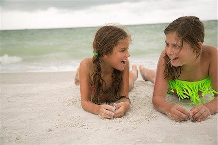 preteen girls bath - Two girl lying on beach Stock Photo - Premium Royalty-Free, Code: 6102-08760638