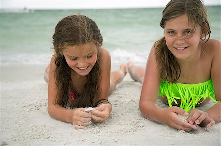 preteen girls bath - Two girl lying on beach Stock Photo - Premium Royalty-Free, Code: 6102-08760639