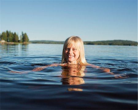 preteen girls bath - Girl swimming in lake, Siljan, Dalarna, Sweden Stock Photo - Premium Royalty-Free, Code: 6102-08761319