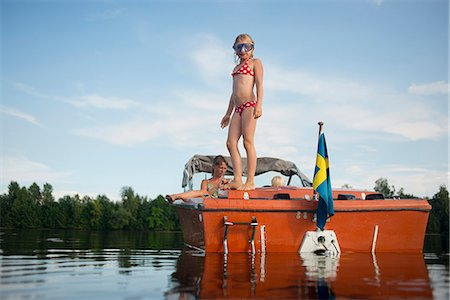 Girl on boat, Siljan, Dalarna, Sweden Stock Photo - Premium Royalty-Free, Code: 6102-08761329