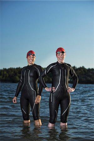 Women in wetsuit in sea, Sweden Stock Photo - Premium Royalty-Free, Code: 6102-08761335