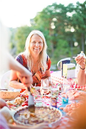 Smiling mature woman at party Stock Photo - Premium Royalty-Free, Code: 6102-08761513