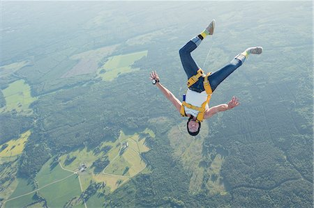 Woman skydiving Stock Photo - Premium Royalty-Free, Code: 6102-08726893