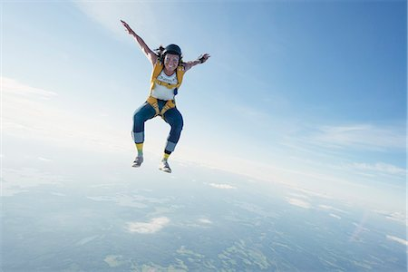 Woman skydiving Stock Photo - Premium Royalty-Free, Code: 6102-08726897