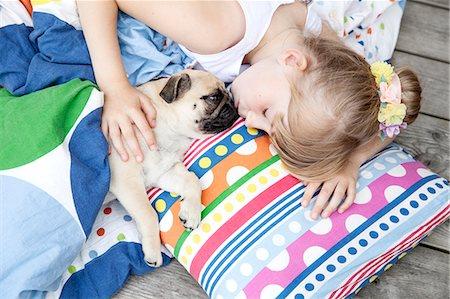 dog kissing girl - Girl with pug Stock Photo - Premium Royalty-Free, Code: 6102-08858430