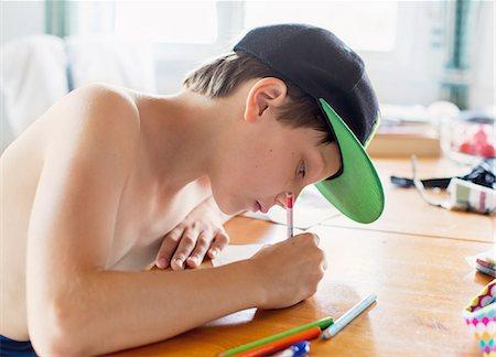 preteen boy shirtless - Boy drawing Stock Photo - Premium Royalty-Free, Code: 6102-08858532