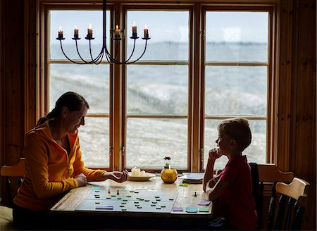 Mother with son playing board game Stock Photo - Premium Royalty-Free, Code: 6102-08885598