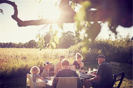 Family having meal in garden Stock Photo - Premium Royalty-Free, Code: 6102-08942320