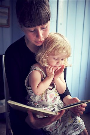 Mother reading book to her daughter Stock Photo - Premium Royalty-Free, Code: 6102-08942509