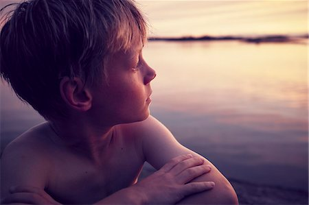 Boy looking away Stock Photo - Premium Royalty-Free, Code: 6102-08942535
